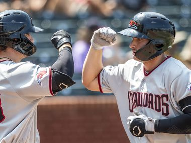 Hickory Crawdad's Justin Foscue (20), right, gets a high fives from Trevor Hauver (33) after hitting a homerun during the game with the Greensboro Grasshoppers at First National Bank Field on Sunday, August 8, 2021 in Greensboro, N.C.
