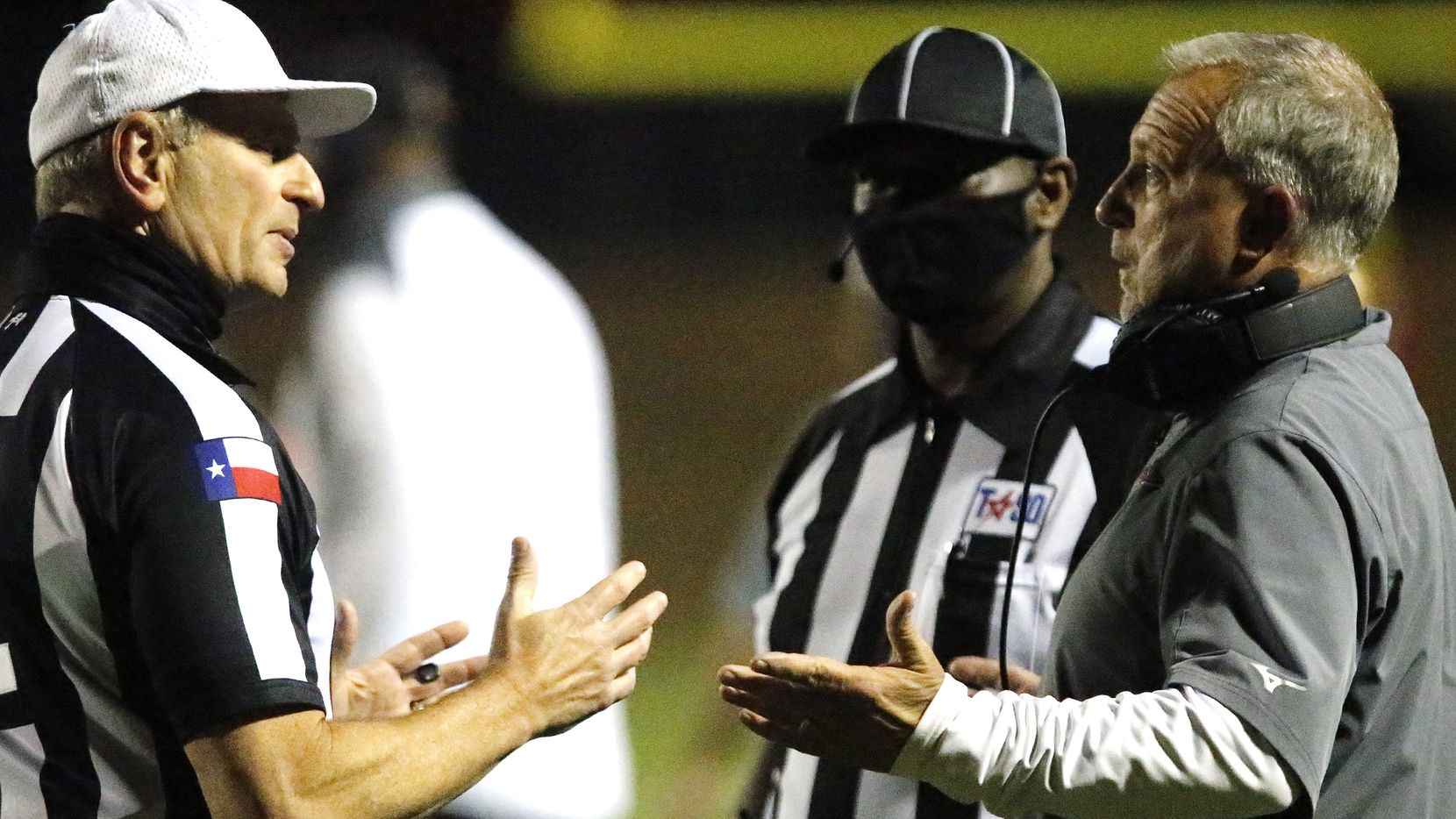 South Grand Prairie football coach Brent Whitson (right) talks with the referees during a first-round playoff win over Lake Highlands on December 11, 2020.