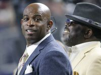 Former Cowboys defensive back Deion Sanders is pictured on the sidelines during the New York Jets vs. Dallas Cowboys NFL football game at AT&T Stadium in Arlington on Saturday, December 19, 2015.