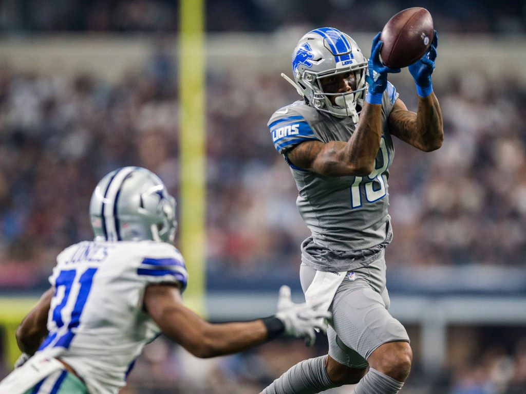 Detroit Lions wide receiver Kenny Golladay (19) catches a pass near Dallas Cowboys cornerback Byron Jones (31) during the fourth quarter of an NFL football game between the Dallas Cowboys and the Detroit Lions on Sunday, September 30, 2018 at AT&T Stadium in Arlington, Texas. (Ashley Landis/The Dallas Morning News)