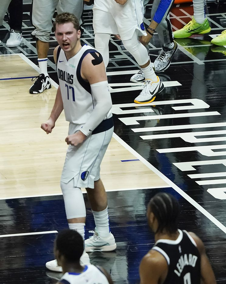 Dallas Mavericks guard Luka Doncic celebrates after LA Clippers forward Kawhi Leonard (2) missed a 3-point attempt with 4.9 seconds left during the fourth quarter of an NBA playoff basketball game at the Staples Center on Wednesday, June 2, 2021, in Los Angeles. The Mavericks won the game 105-100. (Smiley N. Pool/The Dallas Morning News)