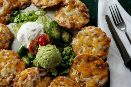Diners enjoy the bean and cheese nachos at Uncle Julio's Mexican restaurant in Dallas.