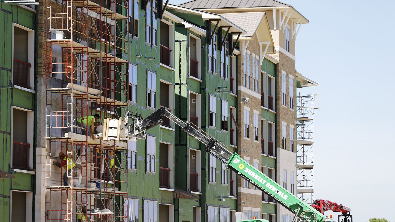 Widespread apartment construction in the Dallas-area held back rent increases in 2018.