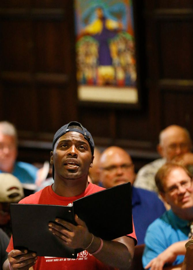 "Dallas Street Choir member Michael Brown raises his voice during a rehearsal for their performance at Carnegie Hall on Wednesday evening, at the Fifth Avenue Presbyterian Church in New York. ""We may be homeless, but we're not voiceless,"" he said at the rehearsal Tuesday, ""so let's use our effort to remind people that we still have hope and it will never die."""