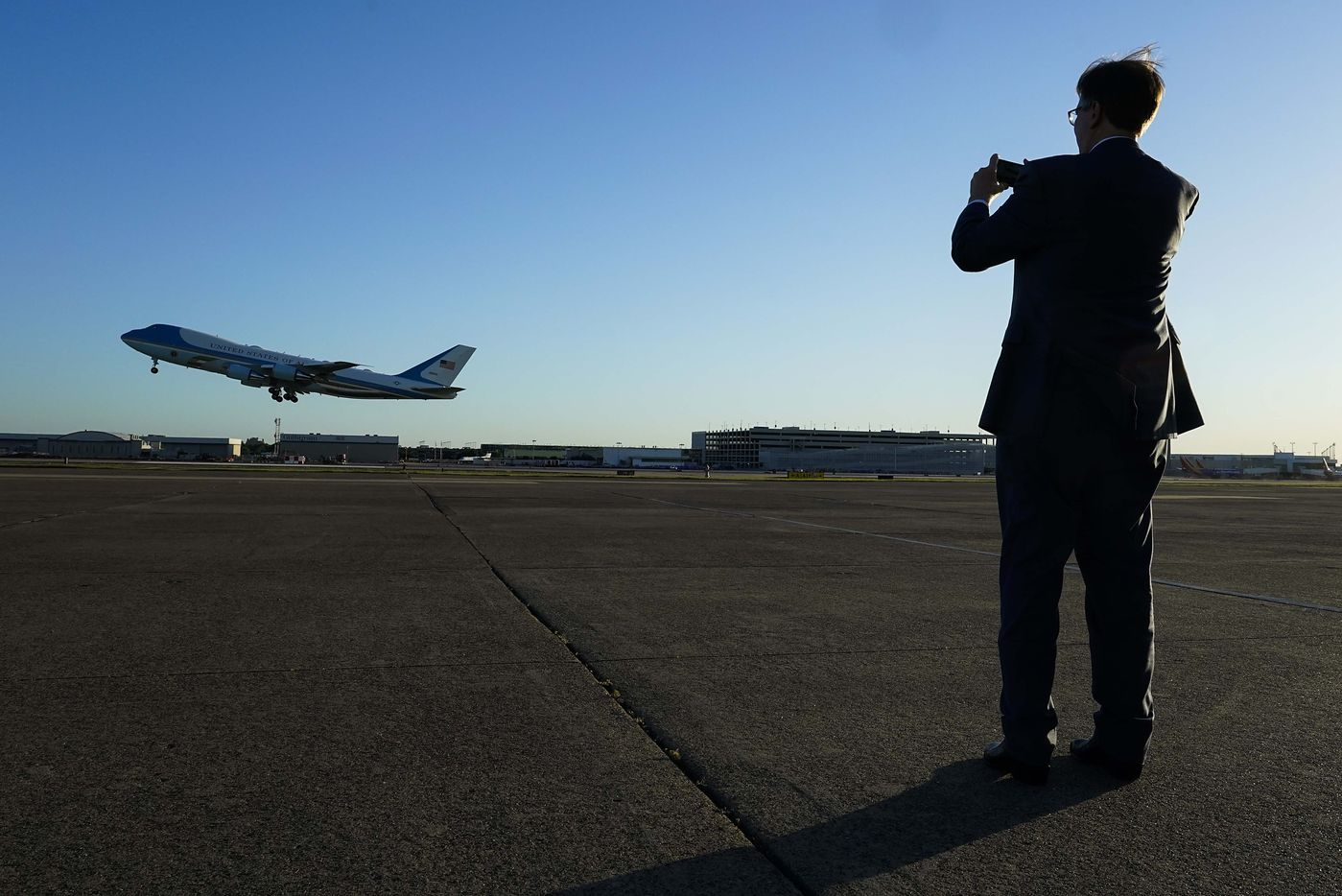 Texas Lt. Gov. Dan Patrick photographs Air Force One as it takes off from Dallas Love Field Airport after President Donald Trump participated in a roundtable conversation about race relations and policing and attended a fundraiser at a private residence on Thursday, June 11, 2020, in Dallas. (Smiley N. Pool/The Dallas Morning News)