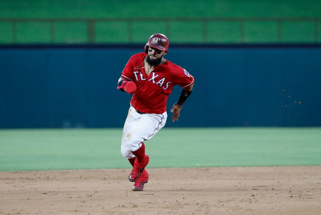 Texas Rangers' Rougned Odor sprints to third during a baseball game against the Cleveland Indians in Arlington, Texas, Wednesday, June 19, 2019. (AP Photo/Tony Gutierrez)