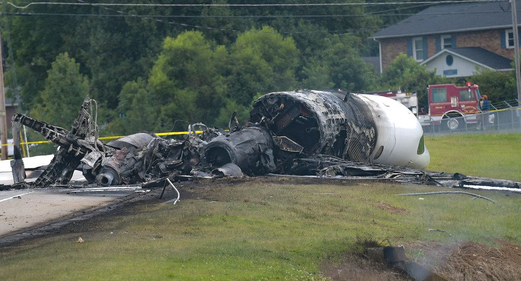 """The burned remains of a plane that was carrying NASCAR television analyst and former driver Dale Earnhardt Jr. lie near a runway Thursday, Aug. 15, 2019, in Elizabethton, Tenn. Officials said the Cessna Citation rolled off the end of a runway and caught fire after landing at Elizabethton Municipal Airport. Earnhardt's sister, Kelley Earnhardt Miller, tweeted that """"everyone is safe and has been taken to the hospital for further evaluation."""" (Earl Neikirk/Bristol Herald Courier via AP)"""