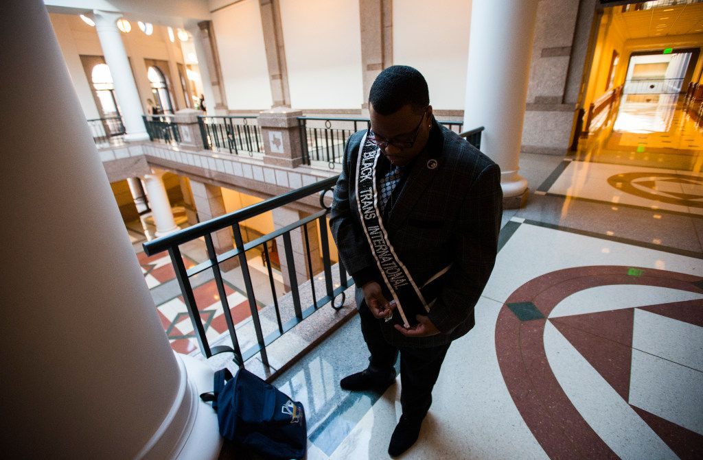 Trenton Johnson puts on his Mr. Black Trans International sash before entering a hearing room to voice his opposition to the bathroom bill at a Senate State Affairs Committee public hearing on the fourth day of a special legislative session on Friday, July 21, 2017 at the Texas state capitol in Austin, Texas. (Ashley Landis/The Dallas Morning News)