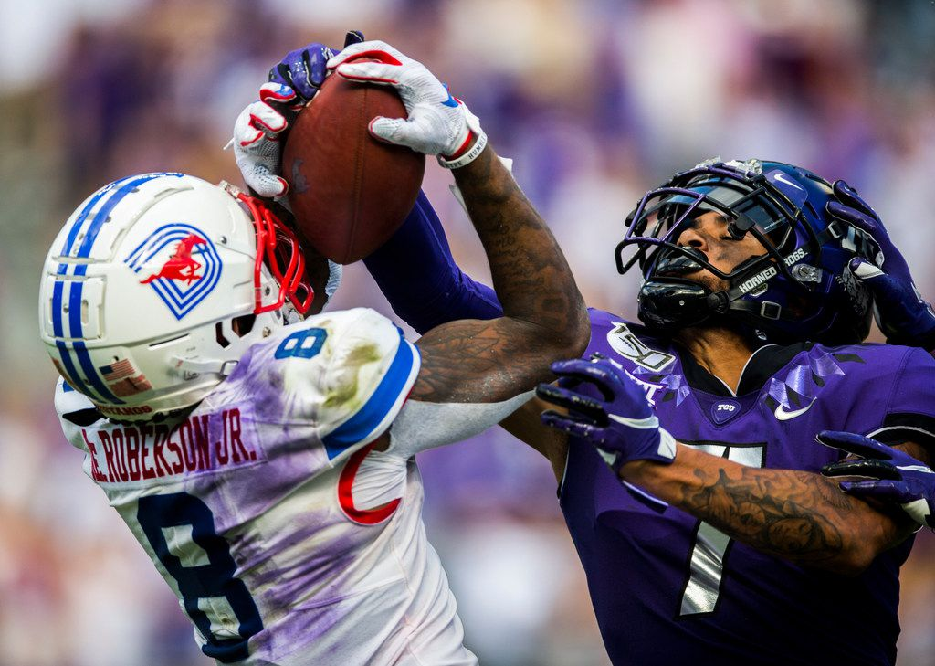 FILE - SMU wide receiver Reggie Roberson Jr. (8) catches a pass over TCU safety Trevon Moehrig (7) during the second quarter of a game on Saturday, Sept. 21, 2019, at Amon G. Carter Stadium in Fort Worth.