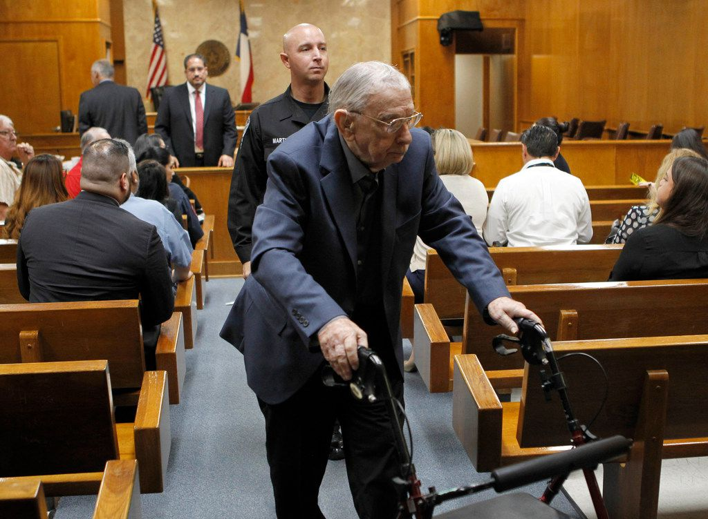 John Feit exits the the 92nd State District Court during a break for lunch in his trial for the 1960 murder of Irene Garza on Friday.