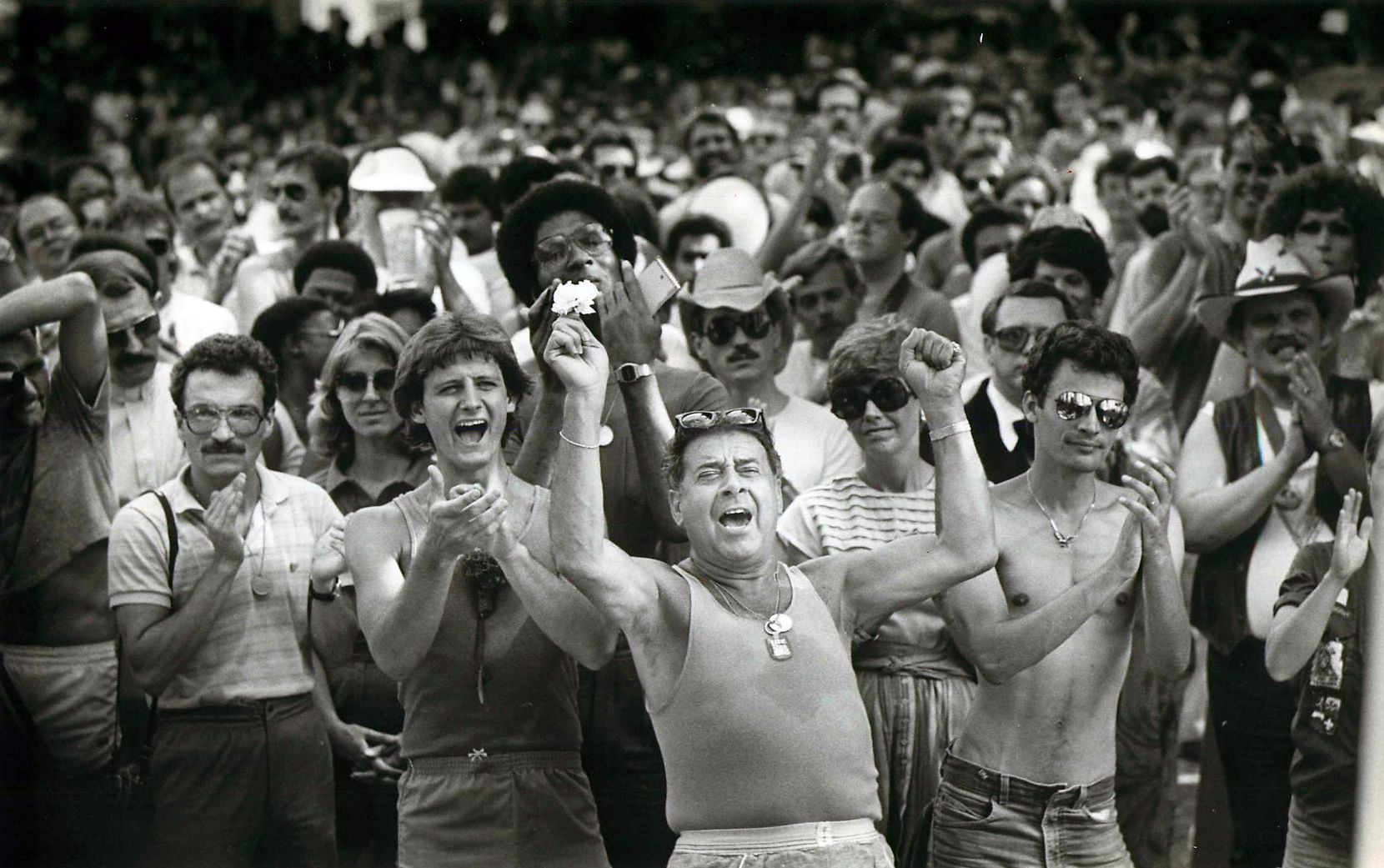 Gay supporters applaud a speaker in Lee Park after the Pride Parade in June  1983.