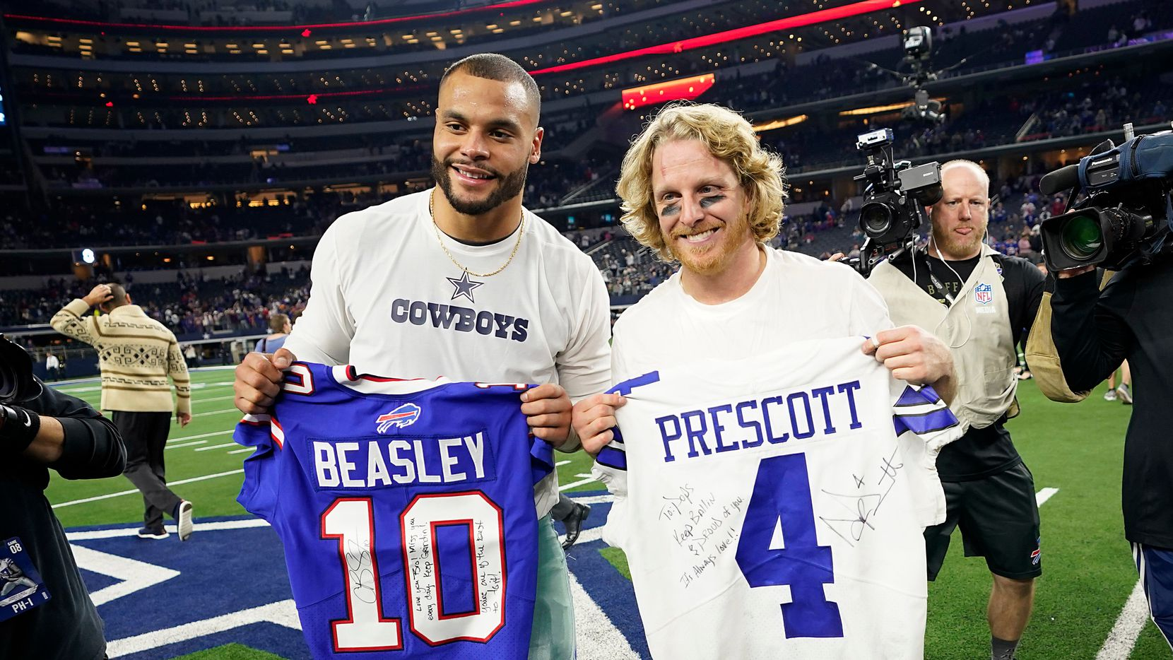 Dallas Cowboys quarterback Dak Prescott (left) exchanges jersey with Buffalo Bills wide receiver Cole Beasley after an NFL football game at AT&T Stadium on Thursday, Nov. 28, 2019, in Arlington.
