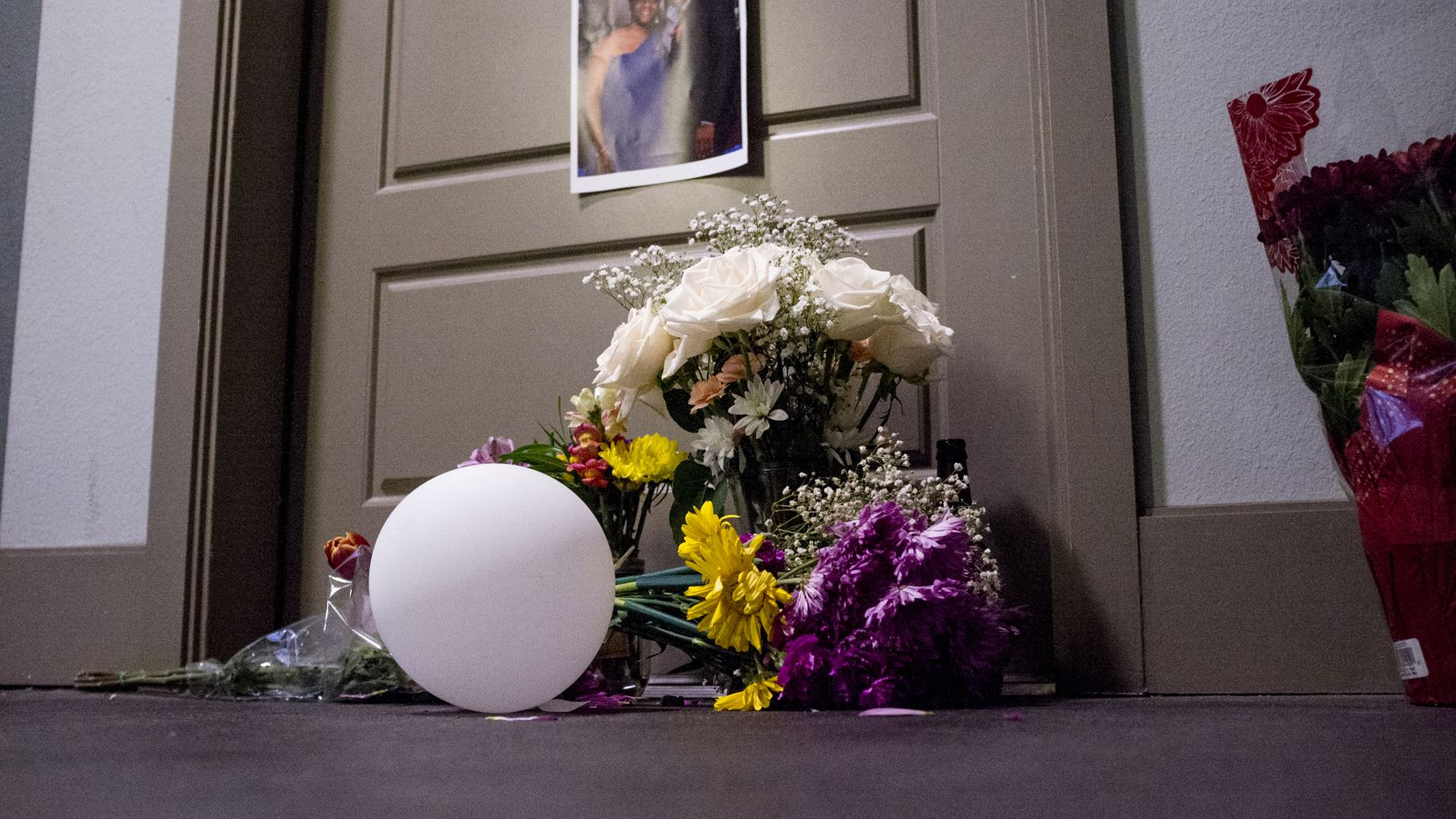 Flowers were placed at the front door apartment of Botham Jean on Sept. 10, 2018 in Dallas. Jean was shot by off-duty Dallas police officer Amber Guyger, who says she mistook his apartment for hers.