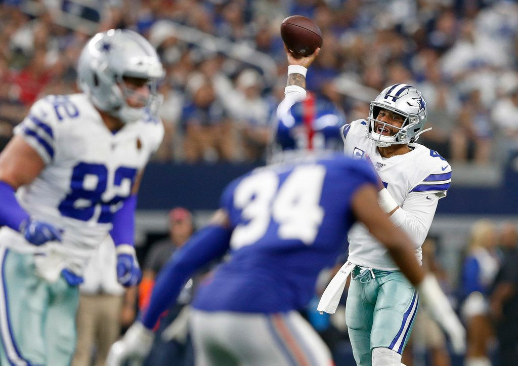 Cowboys quarterback Dak Prescott (4) throws a touchdown pass to wide receiver Randall Cobb (not pictured) during the second half of a game against the New York Giants on Sunday, Sept. 8, 2019, at AT&T Stadium in Arlington.