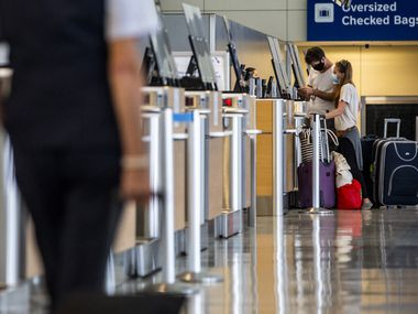 Passengers check their luggage in Terminal D at DFW International Airport in Irving, Texas, on Sunday, July 26, 2020. (Lynda M. Gonzalez/The Dallas Morning News)
