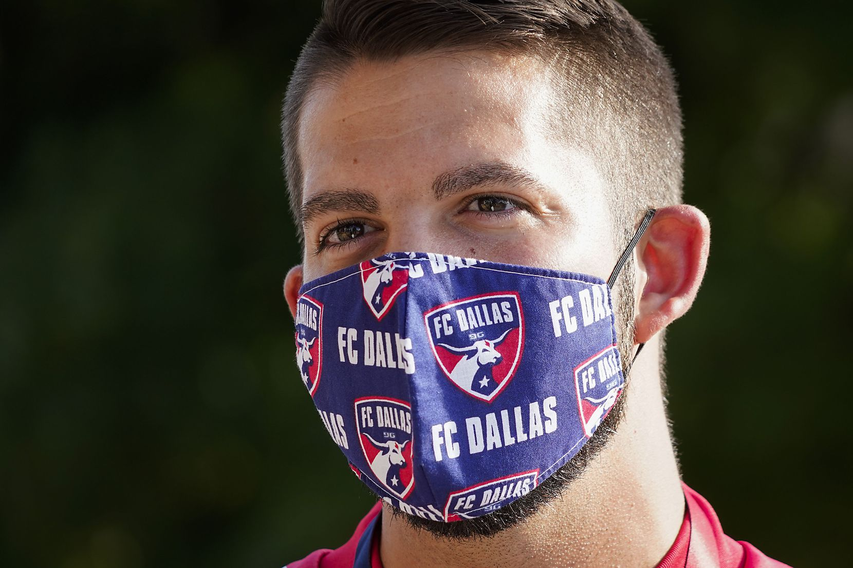 Jeff Files wears a FC Dallas face mask as he waits to enter the West Gate before an MLS soccer game at Toyota Stadium on Wednesday, Aug. 12, 2020, in Frisco, Texas. (Smiley N. Pool/The Dallas Morning News)