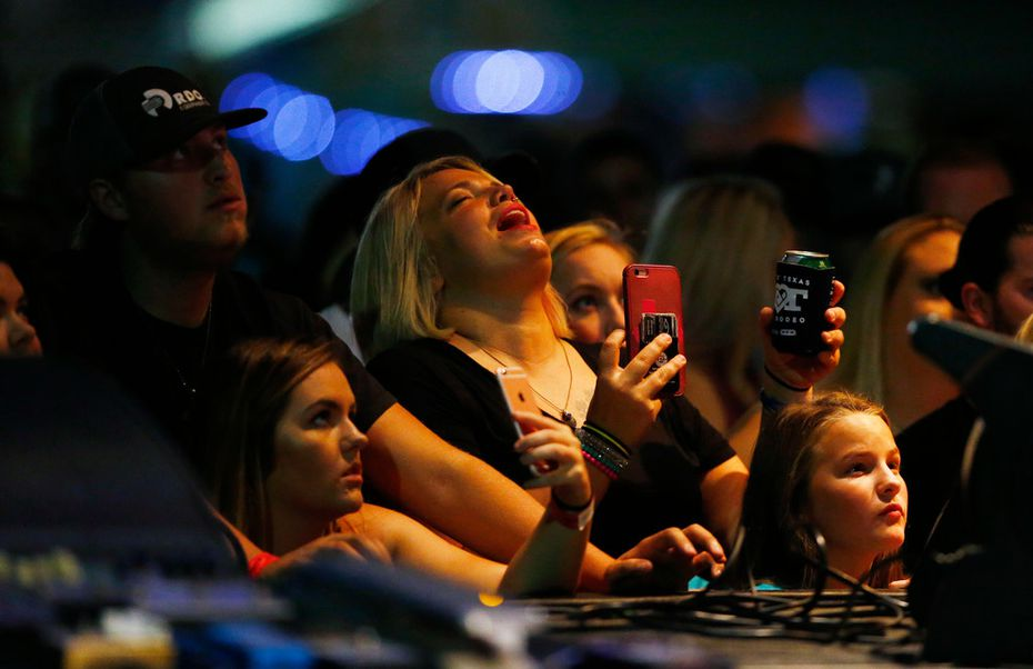 Audience members sing along with Koe Wetzel during the Heart o' Texas Fair in Waco.