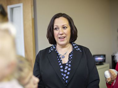 U.S. Senate hopeful MJ Hegar, shown visiting families at a toy distribution at Austin's Camp Mabry on Dec. 14, is a decorated Air Force helicopter rescue pilot. Voters like veterans as candidates because they have a record of self-sacrifice, she says. (Thao Nguyen/Special Contributor)
