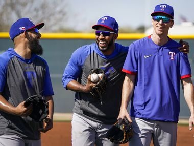 Texas Rangers shortstop Elvis Andrus (center) laughs with second baseman Rougned Odor (left) and infielder Matt Duffy (right) during a spring training workout at the team's training facility on Monday, Feb. 17, 2020, in Surprise, Ariz.