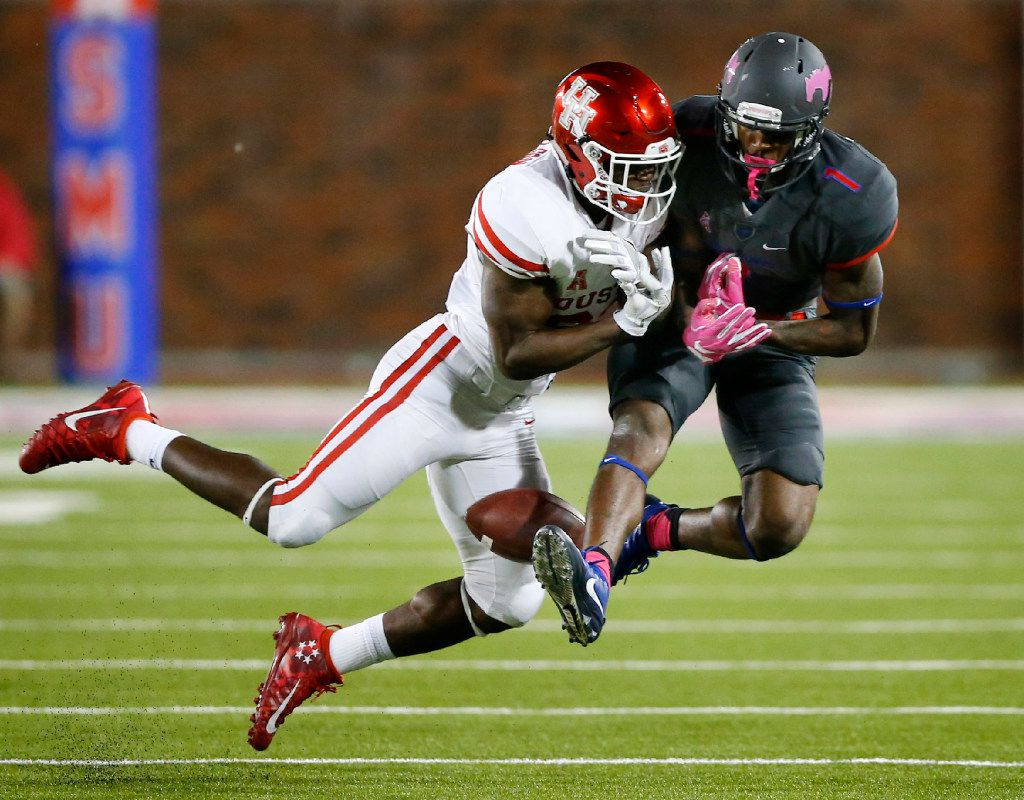 Houston Cougars cornerback Brandon Wilson (26) breaks up a pass intended for Southern Methodist Mustangs wide receiver Kevin Thomas (1) in the third quarter at Gerald J. Ford Stadium in University Park, Texas, Saturday, October 22, 2016. SMU upset Houston, 38-16.  (Tom Fox/The Dallas Morning News)