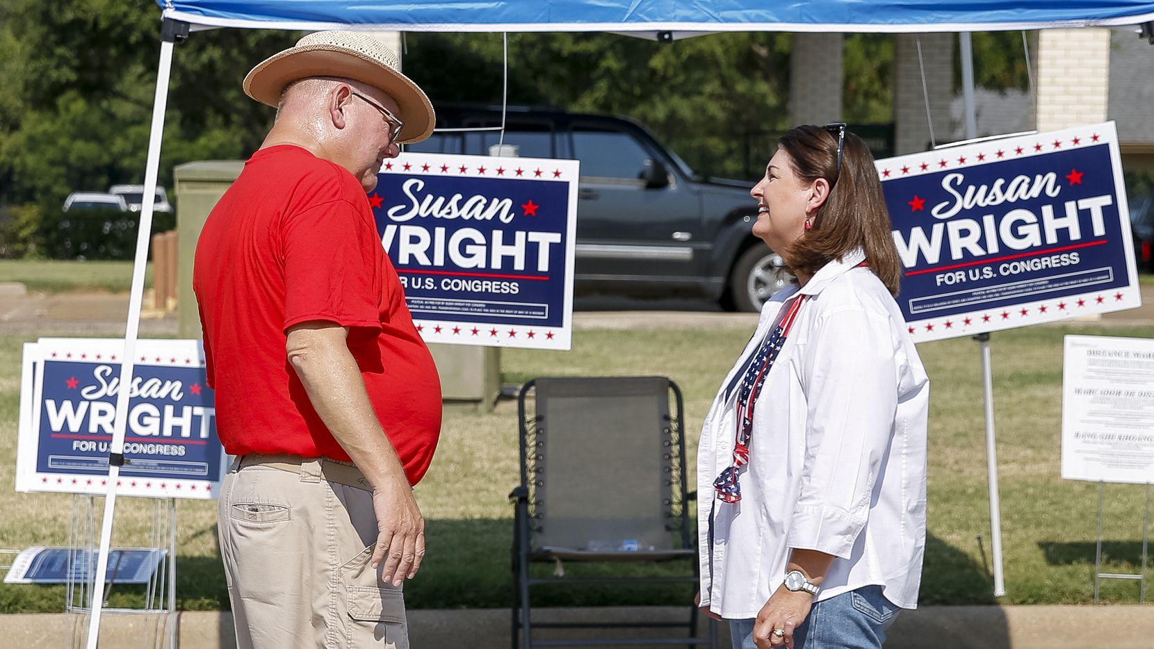 Susan Wright, Republican candidate for Texas' 6th Congressional District (right), speaks with Linton Davis of Arlington outside a polling location during early voting for a special runoff election on Thursday, July 22, 2021, in Arlington. (Elias Valverde II/The Dallas Morning News)