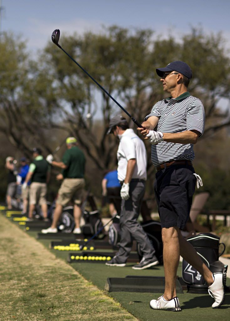 Tal Harris of Plano works on a driving range at the Clubs of Prestonwood.