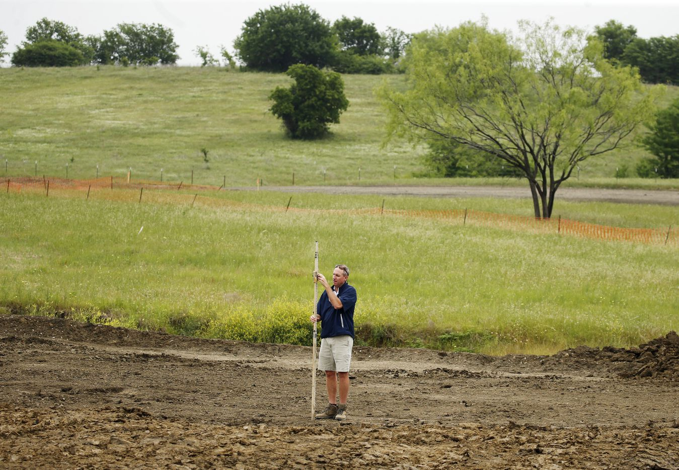 Design partner, Jim Wagner of Gil Hanse Design works on the 14th green of the East Course at PGA Frisco in Frisco, Texas, on Wednesday, May 20, 2020. The $520 million project is a mixed-use development that will be home to the PGA of America headquarters and two championship golf courses.