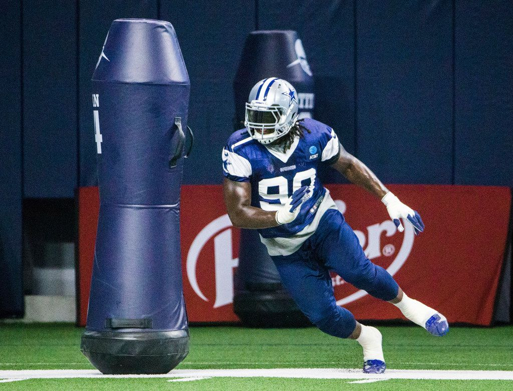Dallas Cowboys defensive end Demarcus Lawrence (90) runs a drill during a Dallas Cowboys training camp practice on Thursday, August 22, 2019 at The Star in Frisco.