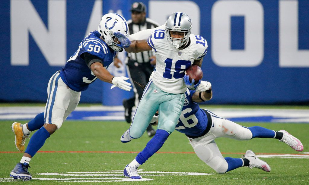 Dallas Cowboys wide receiver Amari Cooper (19) tries to maneuver around Indianapolis Colts Anthony Walker (50) and Clayton Geathers (26) after a pass catch during the Dallas Cowboys vs. the Indianapolis Colts NFL football game at Lucas Oil Stadium in Indianapolis on Sunday, December 16, 2018. (Louis DeLuca/The Dallas Morning News)