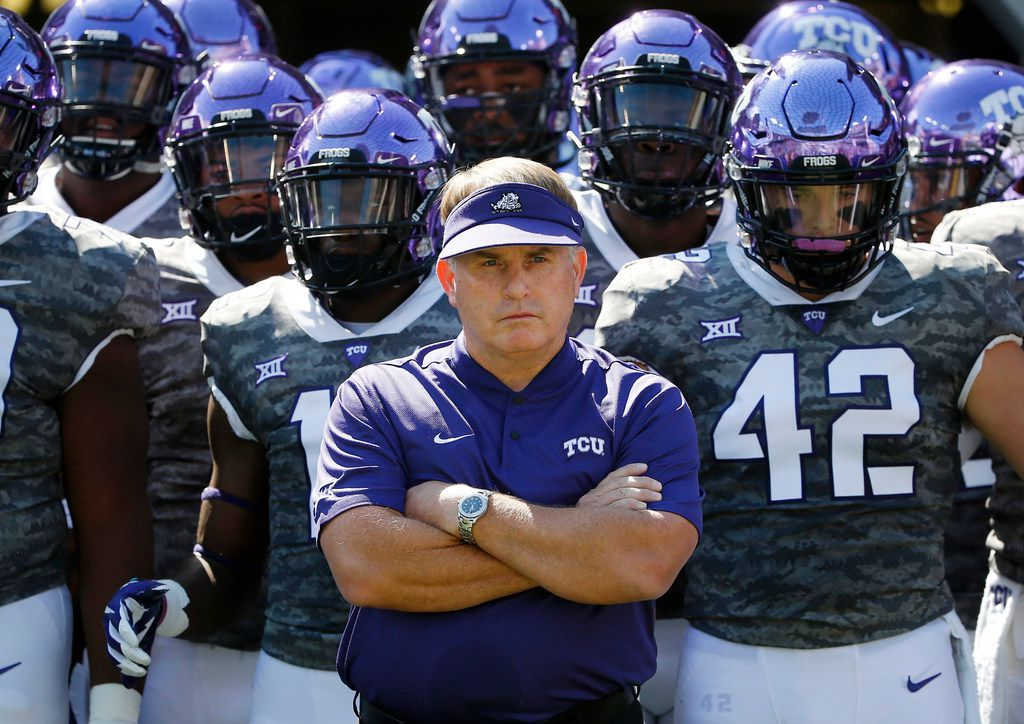 FILE - In this Saturday, Sept. 1, 2018, file photo, TCU head coach Gary Patterson stands with his team in the tunnel exit before running onto the field for an NCAA college football game against Southern University in Fort Worth, Texas. (AP Photo/Ron Jenkins, File)