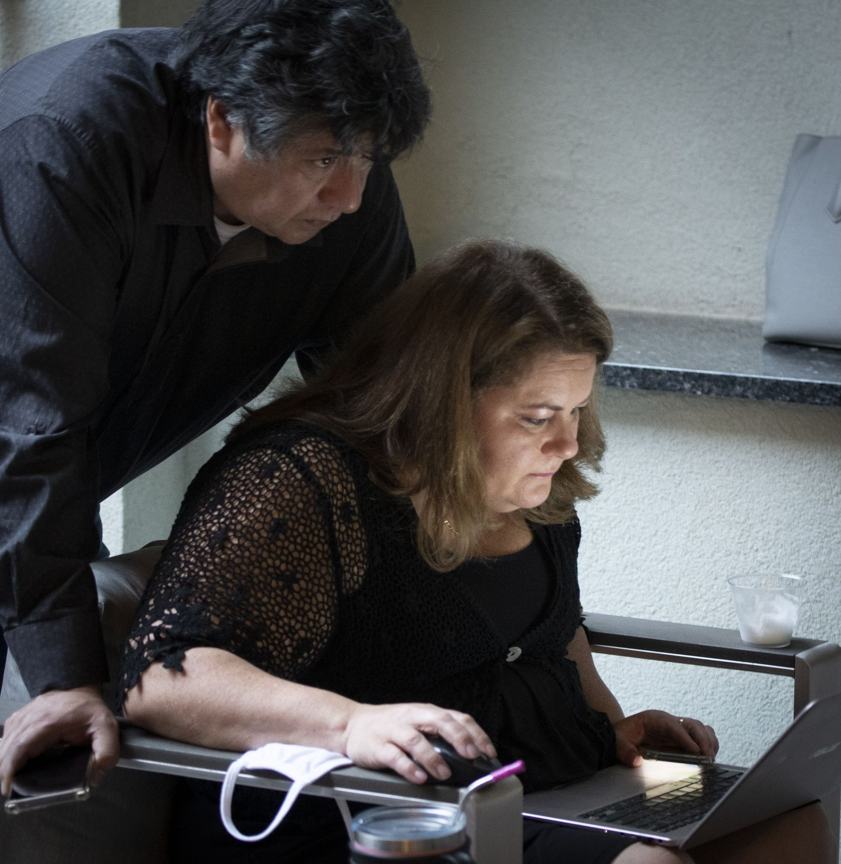 Democrat Jana Sanchez looks at election returns in the District 6 Special election while her friend Juan Saenz, looks over her shoulder Saturday May 1, 2021 in Fort Worth, Texas. (Robert W. Hart/Special Contributor)