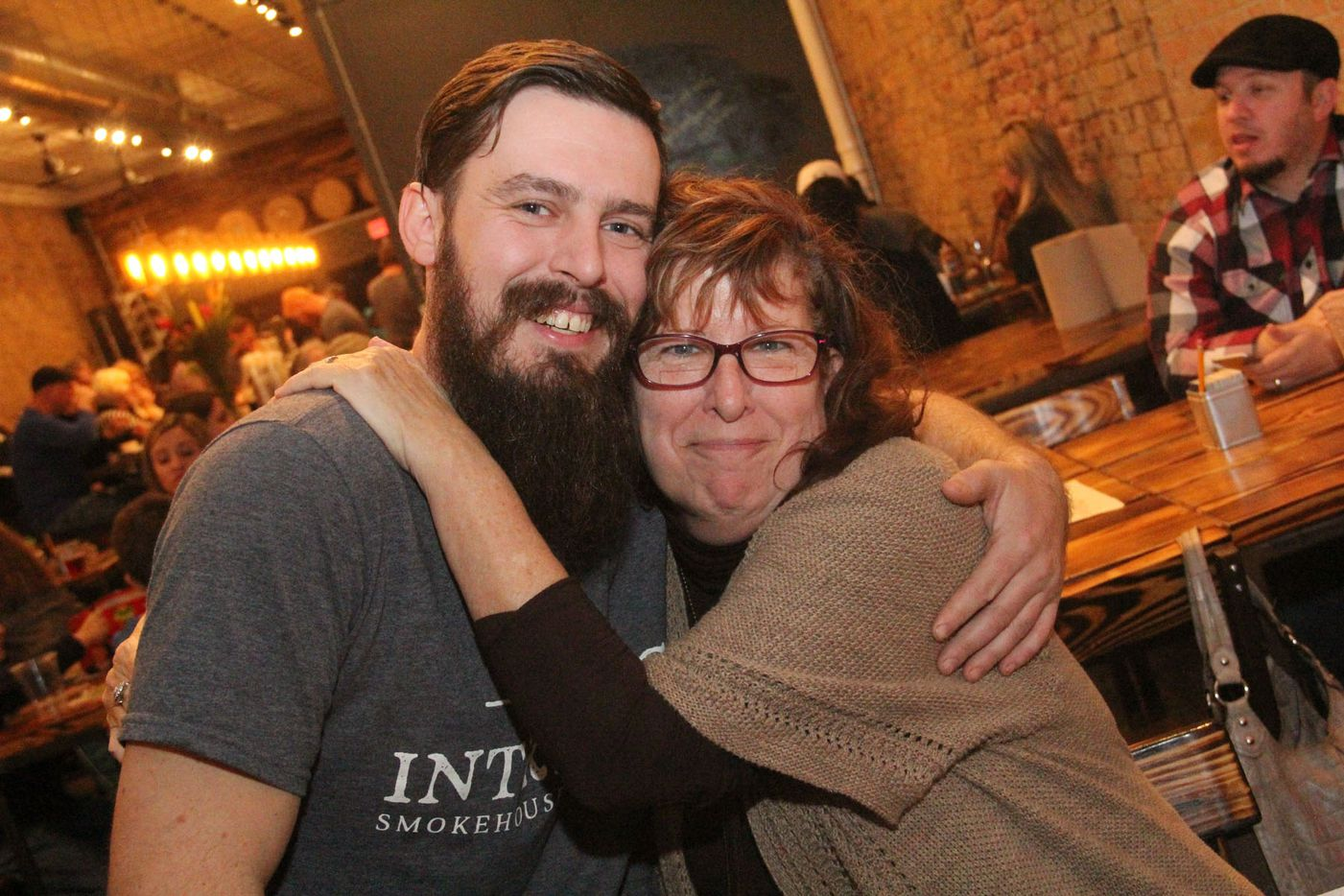 Intrinsic Smokehouse and Brewery owner Cary Hodson and his mother at the brewpub's grand opening on December 5, 2015.