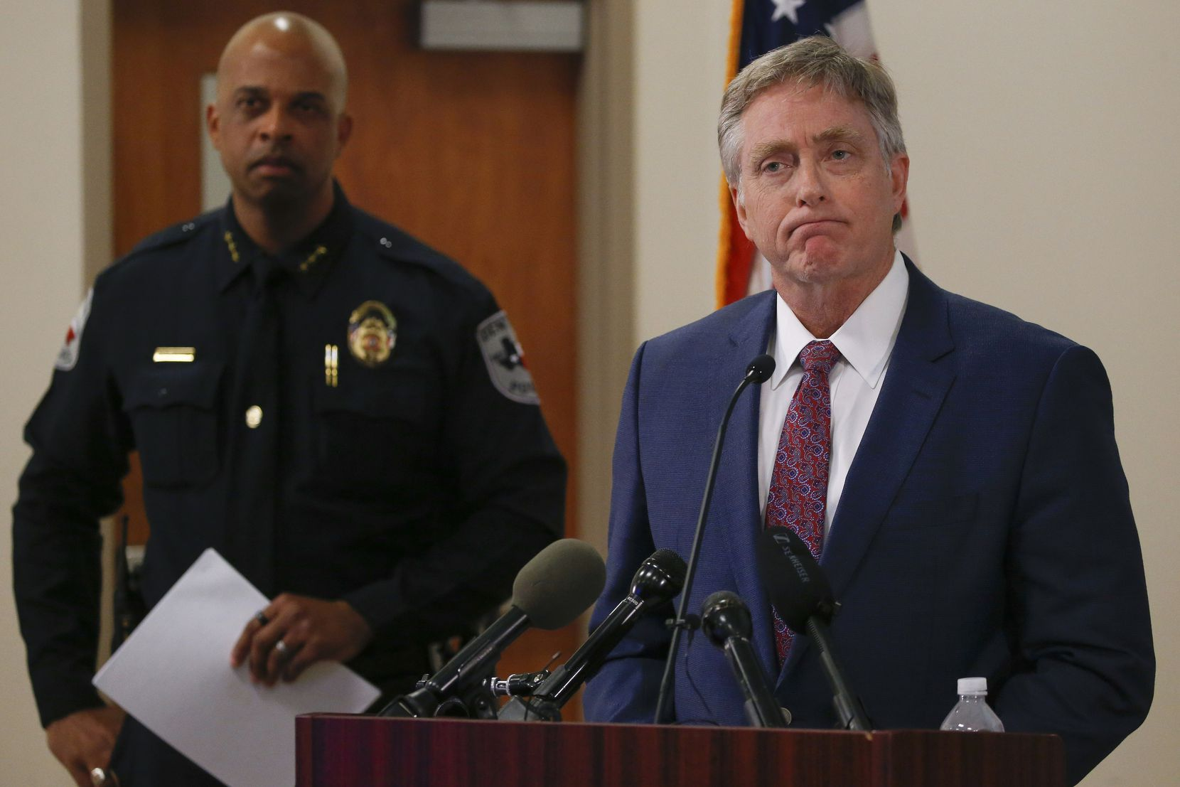 Denton Mayor Chris Watts (right) urged patience from the public in the Darius Tarver case last year. Denton Police Chief Frank Dixon is at rear.