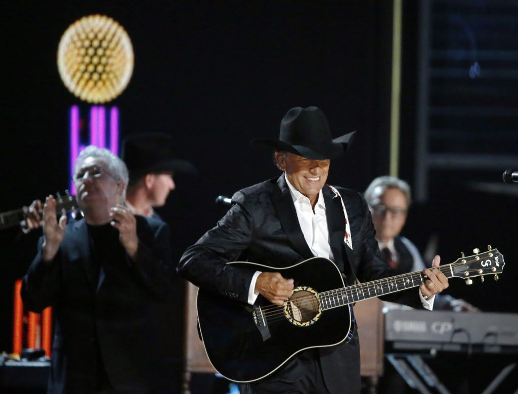George Strait performs during the 2015 Academy of County Music Awards Sunday, April 19, 2015 at AT&T Stadium in Arlington, Texas.