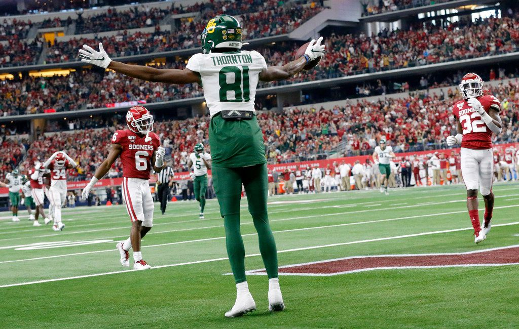 Baylor Bears wide receiver Tyquan Thornton (81) celebrates his second quarter touchdown against the Oklahoma Sooners in the Big 12 Championship at AT&T Stadium in Arlington, Saturday, December 7, 2019.