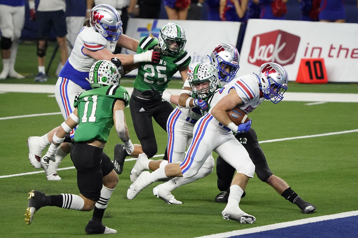 Austin Westlake running back Grey Nakfoor (22) scores on a touchdown run past Southlake Carroll defensive back Josh Spaeth (11) during the fourth quarter of the Class 6A Division I state football championship game at AT&T Stadium on Saturday, Jan. 16, 2021, in Arlington, Texas. Westlake won the game 52-34.