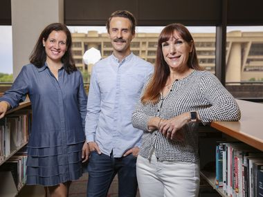 Jennifer Scripps of the Office of Arts and Culture (left), Will Evans of Deep Vellum (center) and Jo Giudice of the Dallas Public Library (right) gather on the third floor of the J. Erik Jonsson Central Library in Dallas on Tuesday, June 8, 2021. The three joined forces to plan Dallas' new poet laureate program.