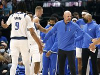 Dallas Mavericks head coach Jason Kidd slaps hands with his center Moses Brown (9) and guard Josh Green (8) during a first half timeout against the Utah Jazz at the American Airlines Center in Dallas, Wednesday, October 6, 2021.