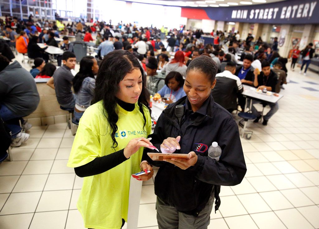Duncanville High School senior Heavyn Leigh Nealy (left) helps school security monitor Amanda Durden sign up to be a bone marrow donor during lunchtime in the high school cafeteria in Duncanville, Texas, Thursday, March 21, 2019. The marrow drive was for freshman David Mojica, who suffers from aplastic anemia, a rare and life-threatening blood disorder. But it also is for those who are also in need of a bone-marrow transplant. The May 2018 diagnosis quickly put David in desperate need of a transplant.