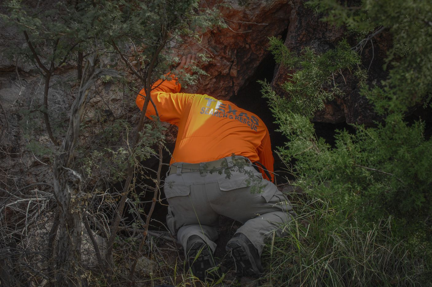 Kelley Janysek, a member of Texas Search and Rescue checks out a small cave Saturday, Oct. 22, 2016 while searching for  Zuzu Verk.
