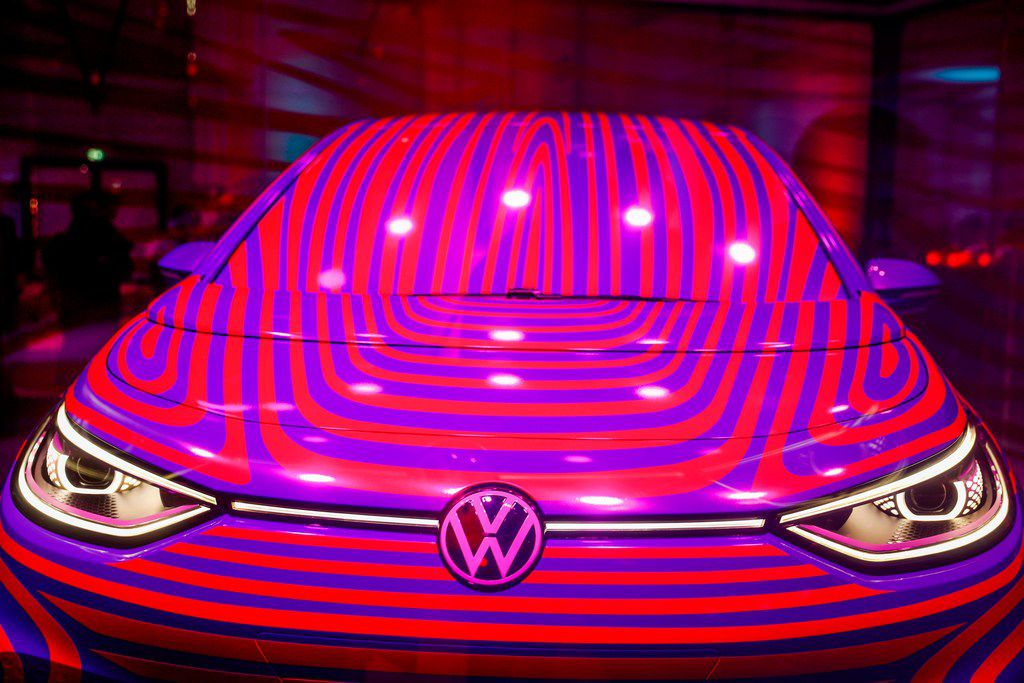 A Volkswagen ID 3 electric car is seen in a glass cage during a press conference in Berlin on May 8, 2019.