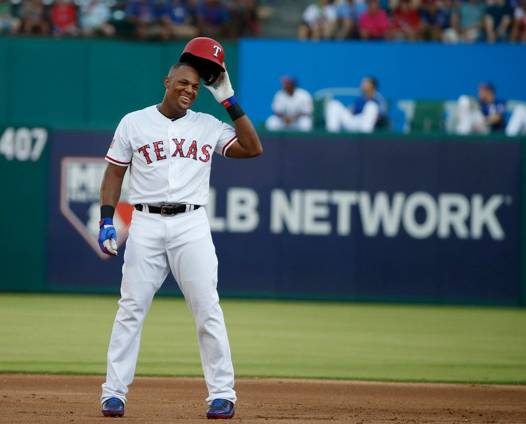 FILE - In this July 4, 2017, file photo, Texas Rangers third baseman Adrian Beltre (29) celebrates his 600th career double off Boston Red Sox starting pitcher David Price (24) during the first inning of a baseball game, in Arlington, Texas. Beltre has decided to retire after 21 seasons and 3,166 hits in the majors leagues. Beltre announced his decision in a statement released by the Rangers on Tuesday morning, Nov. 20, 2018. (AP Photo/Michael Ainsworth, File)