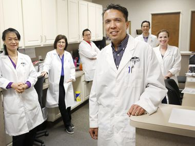 Dr. Stephen Buksh (foreground), a Euless doctor for 21 years, is pictured with fellow doctors at Northeast Tarrant Internal Medicine Associates. The practice has not had to lay off or furlough employees, in part because about half its revenue is coming from monthly payments, not fee for services.
