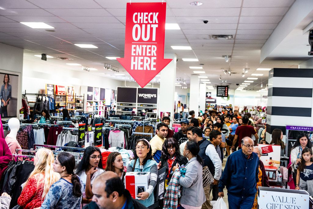 Customers line up to check out during Black Friday shopping at J.C. Penney in Fairview.