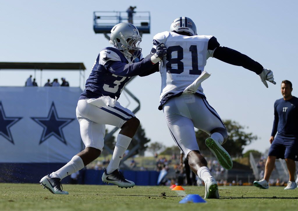 Dallas Cowboys defensive back Jeremiah McKinnon (37) pushes on Dallas Cowboys wide receiver Andy Jones (81) as they run through drills during afternoon practice at training camp in Oxnard, California, Tuesday, August 9, 2016. (Tom Fox/The Dallas Morning News)