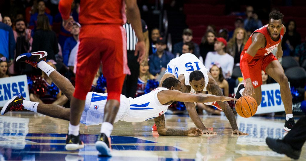 Southern Methodist Mustangs guard Tyson Jolly (0), forward Isiaha Mike (15) and Houston Cougars forward Fabian White Jr. (35) reach for a loose ball during the first half of a basketball game between SMU and University of Houston on Saturday, February 15, 2020 at Moody Coliseum in Dallas. (Ashley Landis/The Dallas Morning News)