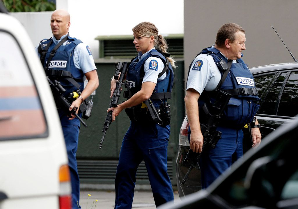 Armed police patrol outside a mosque in central Christchurch, New Zealand.