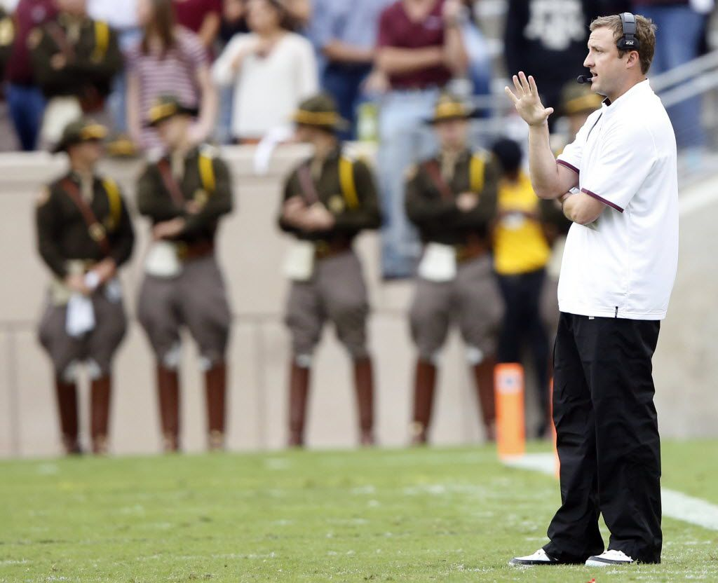 Texas A&M Aggies offensive coordinator Jake Spavital communicates to his players during the second half of play at Kyle Field in College Station, on Saturday, October 31, 2015. Texas A&M Aggies defeated South Carolina Gamecocks 35-28. (Vernon Bryant/The Dallas Morning News)