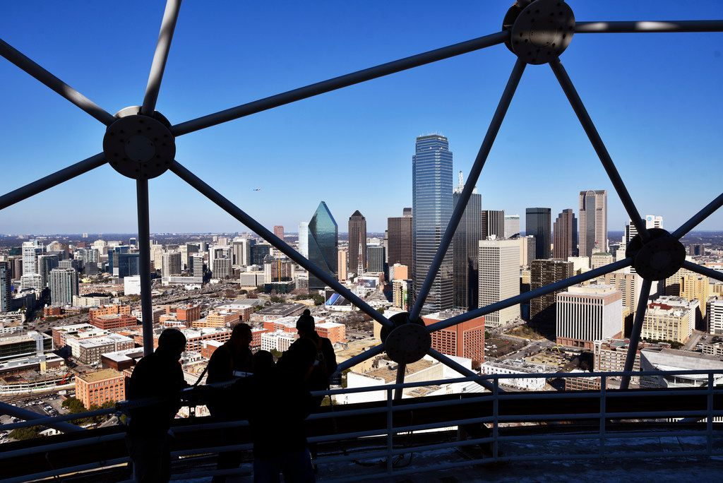 Pyrotechnicians sit on beams near the edge of Reunion Tower as they install fireworks for this year's New Years Eve celebration, Dec. 28, 2018. The Chicago based company has been working the New Years Eve show for the past five years.