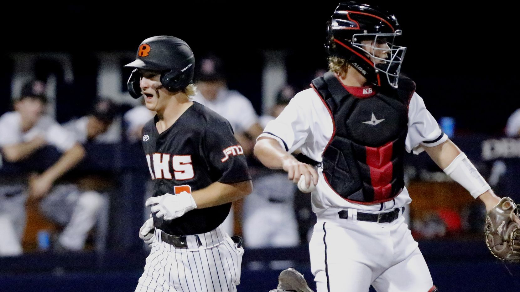 Rockwall shortstop Brayden Randle (2) scores on a bases loaded walk in the fifthl inning as Rockwall Heath High School played Rockwall High School in game one of a 6A Region II final series at Horner Ballpark in Dallas on Wednesday, June 2, 2021.